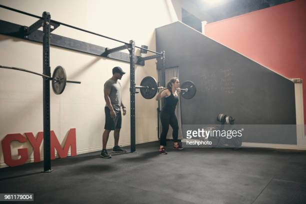 woman in gym weightlifting using barbell - heshphoto stock pictures, royalty-free photos & images