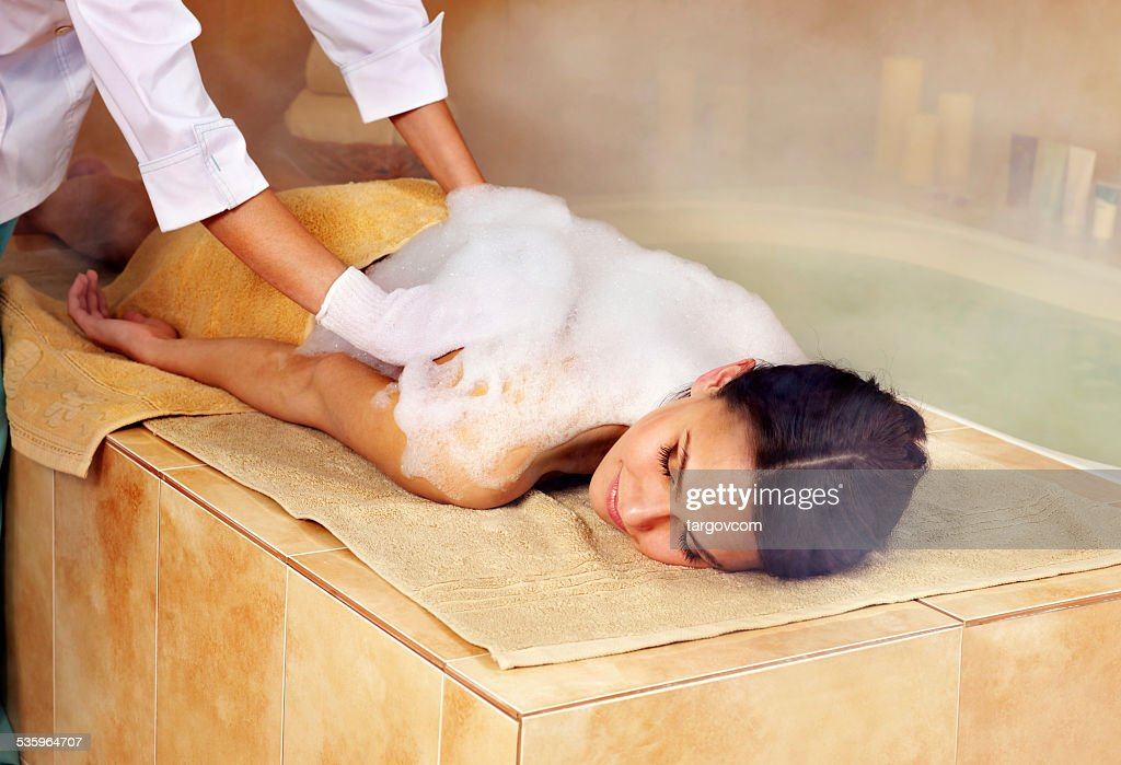 Woman in hammam or turkish bath : Stock Photo