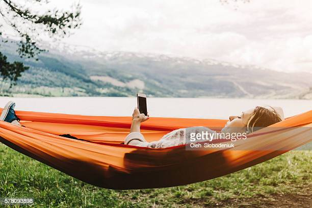 woman in hammock - nordic countries stock photos and pictures