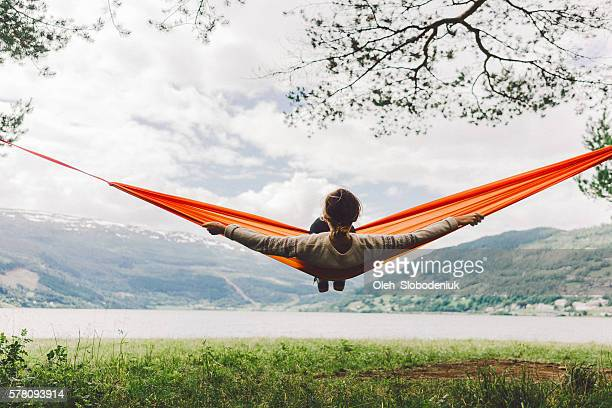woman in hammock - summer stockfoto's en -beelden