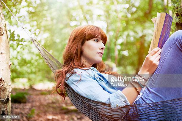 woman in hammock reading book - book stock pictures, royalty-free photos & images