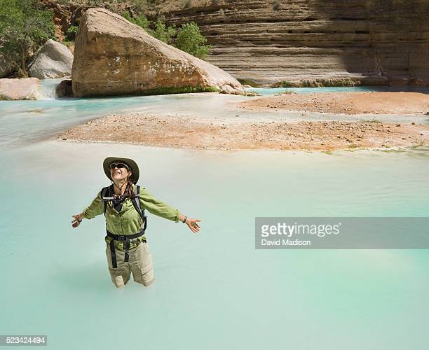 woman in havasu creek, grand canyon national park - havasu creek stock photos and pictures