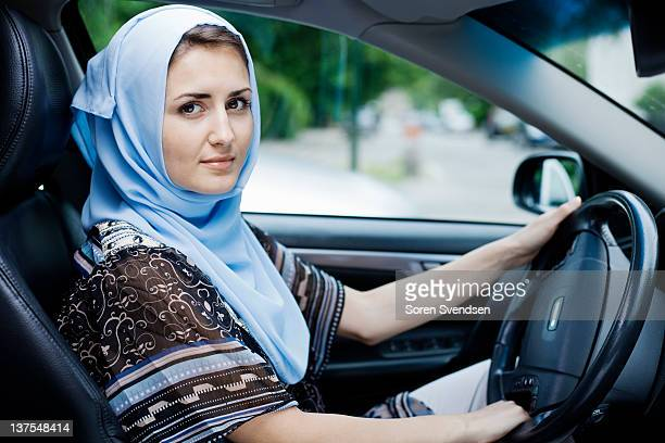 Woman in headscarf driving
