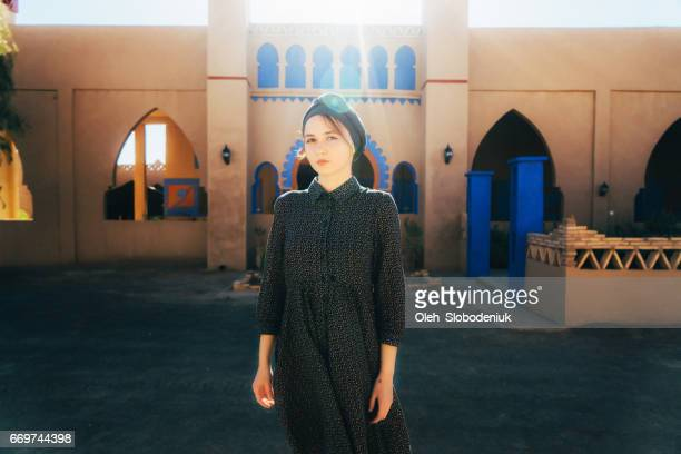 woman in headscarf in casbah in  morocco - hot arab women stock photos and pictures