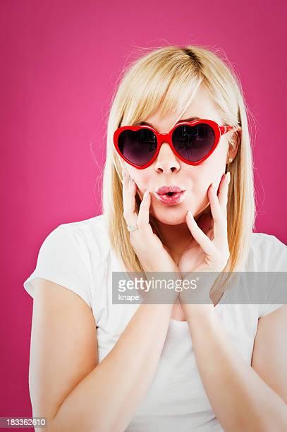 woman in heart sun glasses
