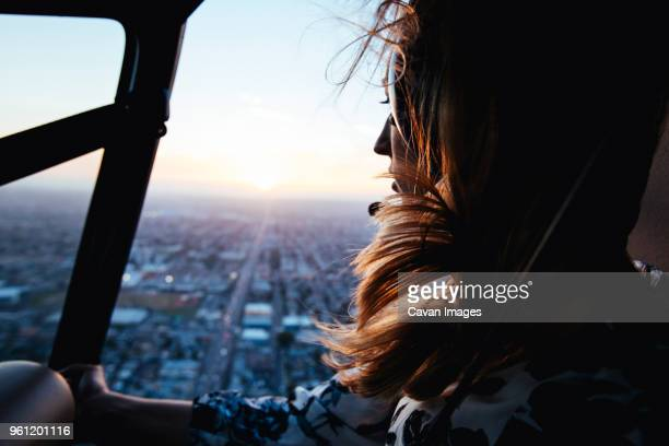 woman in helicopter - helicopter stock pictures, royalty-free photos & images