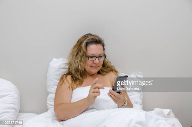 Middle Age Woman Having A Photo Shoot High-Res Stock Photo