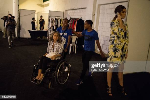 A woman in her wheelchair waiting at backstage before participating in the Walkway Inclusion fashion show in Cali Colombia on November 29 2017 People...