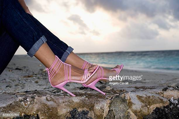 Woman in High Heels at the Beach