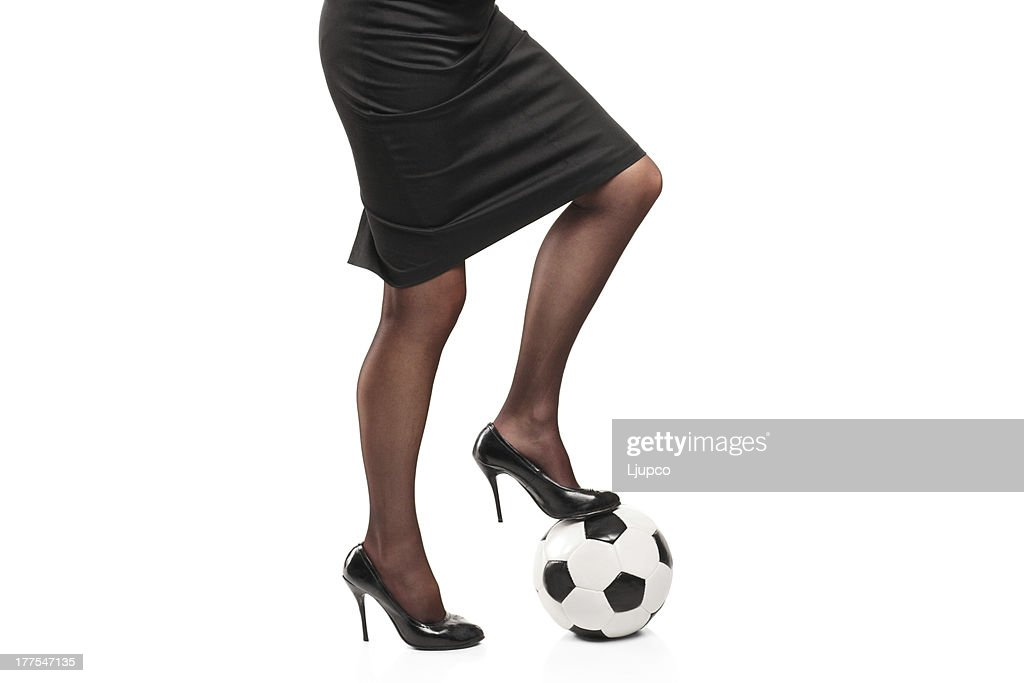 737ca816bedb Woman in high heels standing on a soccer ball   Stock Photo
