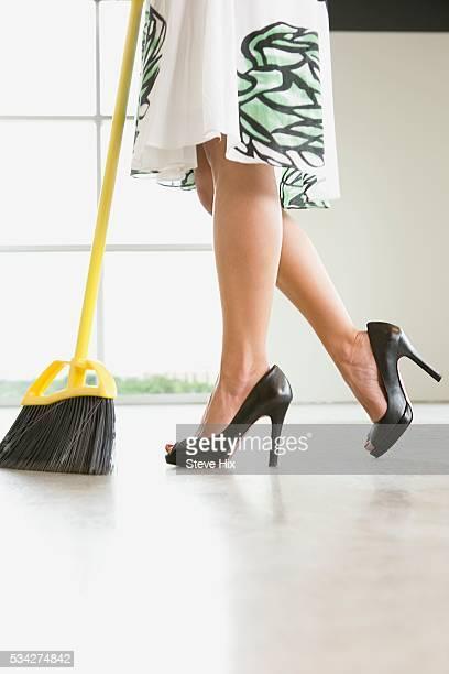 Woman in High Heels Sweeping