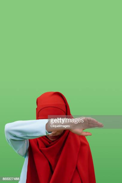 woman in hijab hiding face - cliqueimages stock pictures, royalty-free photos & images