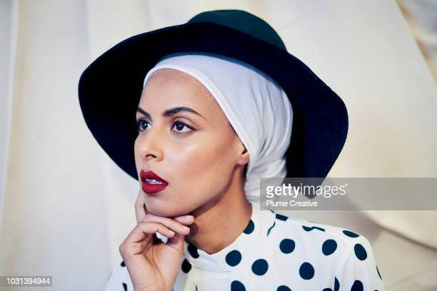 Woman in hijab with a pensive expression