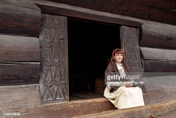 Woman in historic traditional dress at the NORSK FOLKEMUSEUM, Oslo, Bygdøy, Norway.