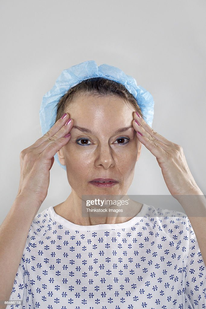Woman in hospital gown : Stock Photo
