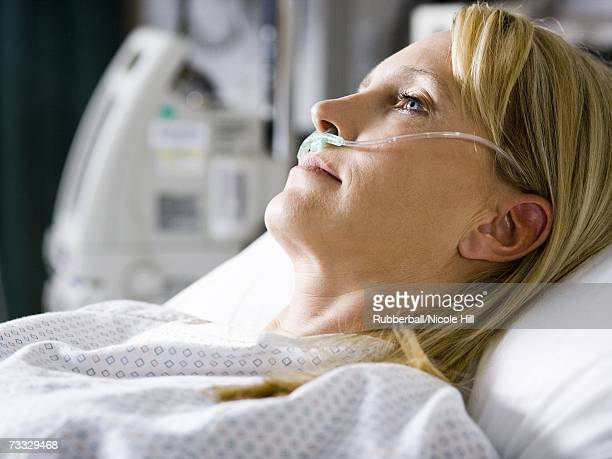 woman in hospital with respirator - hospital ventilator stock pictures, royalty-free photos & images
