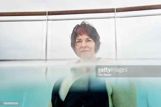 Woman in hot tub with distorted chest.