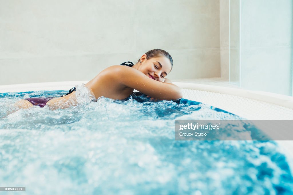 Woman in hot tube : Stock Photo
