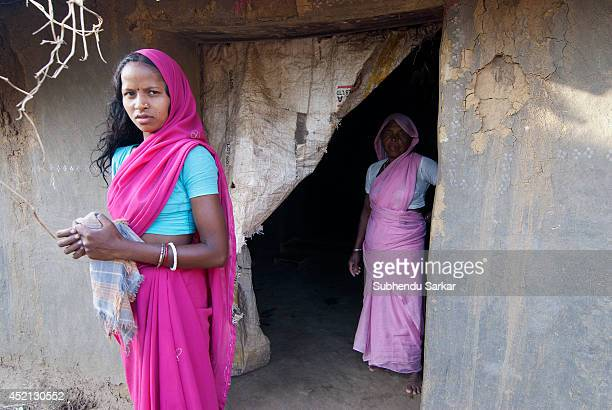A woman in in front of her mud house in a remote village in West Bengal