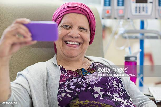 Woman in infusion room taking selfie