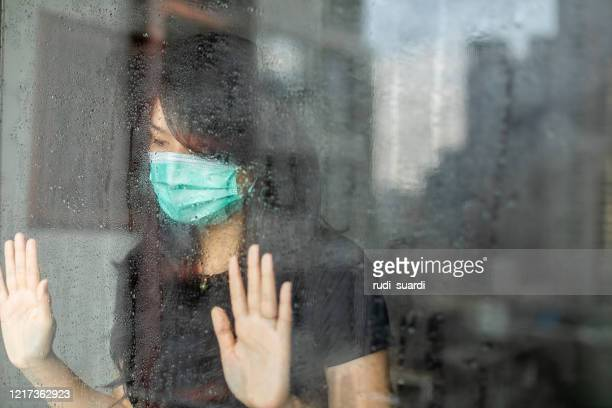 woman in isolation at home for virus outbreak or hypochondria - avoidance stock pictures, royalty-free photos & images