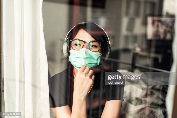 woman in isolation at home for virus outbreak or hypochondria - trap stock pictures, royalty-free photos & images