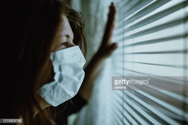 woman in isolation at home for virus outbreak - italy coronavirus stock pictures, royalty-free photos & images