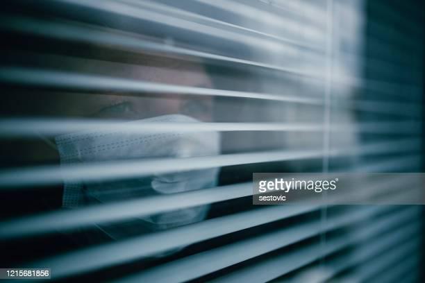 woman in isolation at home for virus outbreak - inquadratura fissa foto e immagini stock