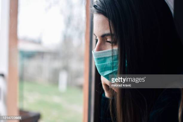 woman in isolation at home - terrified stock pictures, royalty-free photos & images