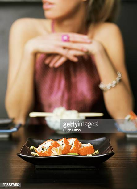 woman in japanese restaurant - hugh sitton stock-fotos und bilder