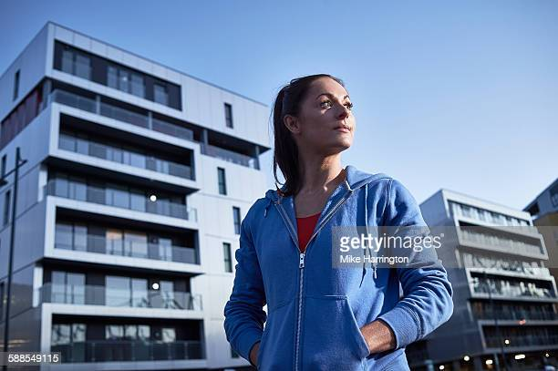 Woman in jogging top in urban environment