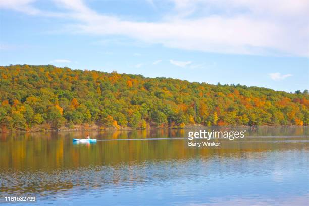 woman in kayak in autumn at lake taghkanic state park, columbia county, new york - barry wood stock pictures, royalty-free photos & images