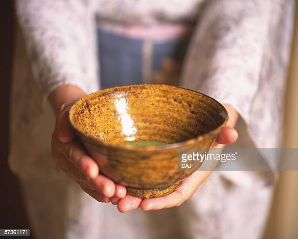woman in kimono holding a cup of green tea, close up - wabi sabi stock pictures, royalty-free photos & images