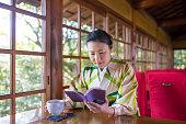 woman kimono holding tea cup bright