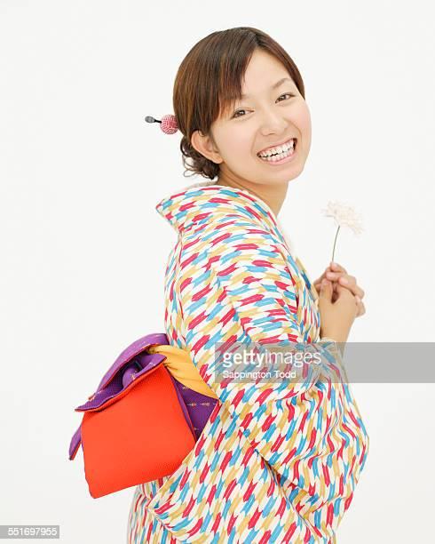 Woman In Kimono Holding Flower