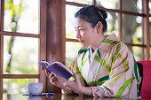 woman kimono looking through window