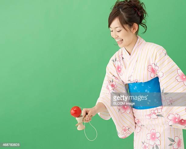 Woman In Kimono Playing With Kendama