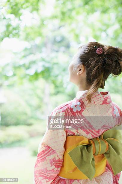 Woman in kimono, rear view