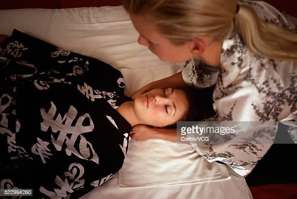 Woman in Kimono Receiving Reiki Shiatsu Massage