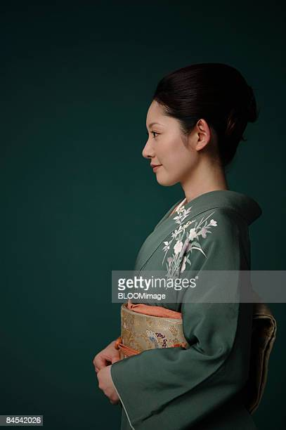 Woman in kimono, side view, portrait, studio shot