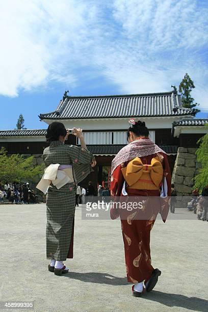 Woman in kimono taking a photo
