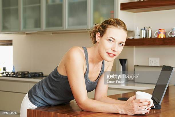 Woman in kitchen looking at camera