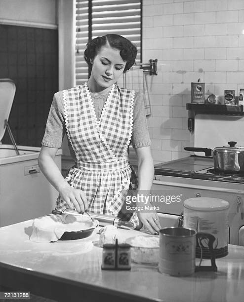 Woman in kitchen making pie (B&W)