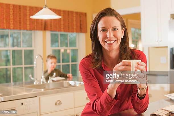 woman in kitchen - incidental people stock pictures, royalty-free photos & images
