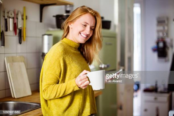 woman in kitchen with coffee - routine stock-fotos und bilder