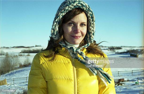 Woman in knit cap with yellow down jacket