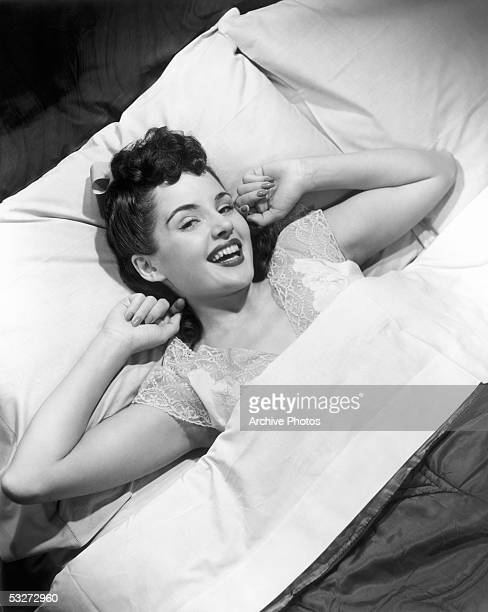 Woman in lace night gown in bed