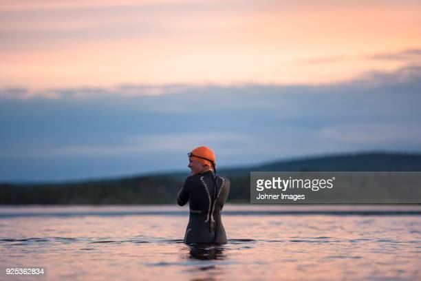 woman in lake - wetsuit stock pictures, royalty-free photos & images