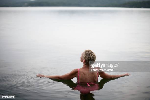 woman in lake - lake bottom stock photos and pictures