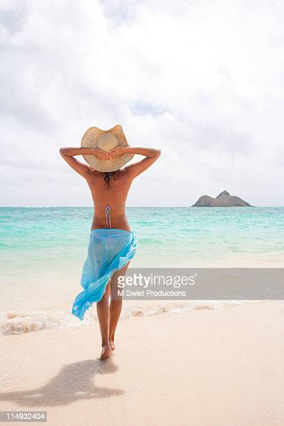 woman in lanikai beach - sarong stock photos and pictures